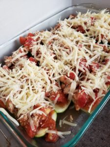 Low Carb, Keto, Chicken Parmesan Stuffed Zucchini. A quick and easy healthy dinner recipe.